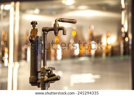 Vintage tap to wooden barrel full of beer - stock photo