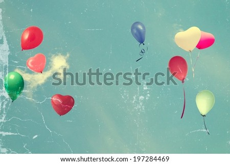 vintage tattered photo paper heart balloon on blue sky concept of love in summer and valentine