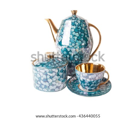 Vintage  teapot, teacup with saucer and sugar-bowl in blue and gold in retro style isolated on white background - stock photo