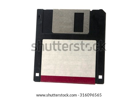 Vintage technology, floppy disk with red tag, classical data storage. - stock photo