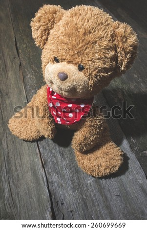 Vintage teddy Bear on wood
