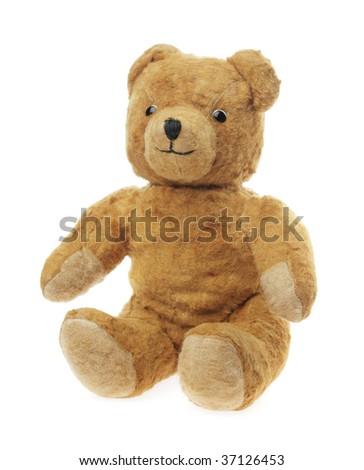 Vintage teddy bear toy sitting on white - stock photo
