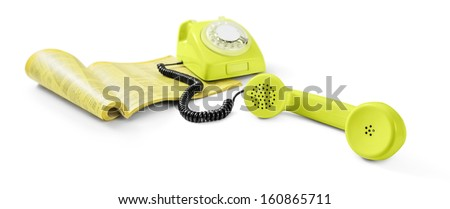 Vintage telephone and phone directory - stock photo