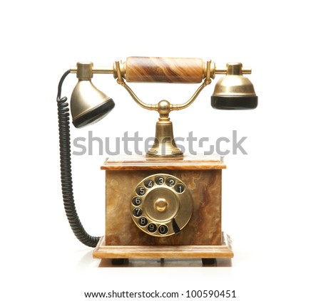 Vintage telephone isolated on white - stock photo