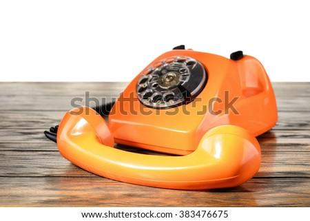 Vintage telephone on desk - stock photo