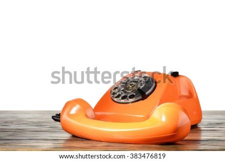 Vintage telephone on desk with isolated background - stock photo