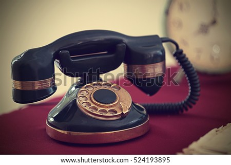 Vintage telephone on red table