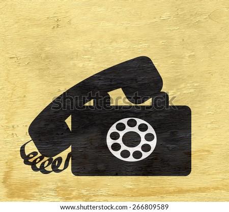 vintage telephone on wood grain texture - stock photo