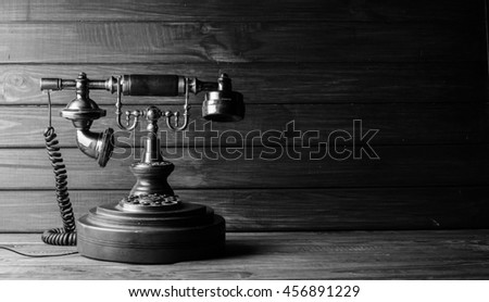 vintage telephone on wooden background