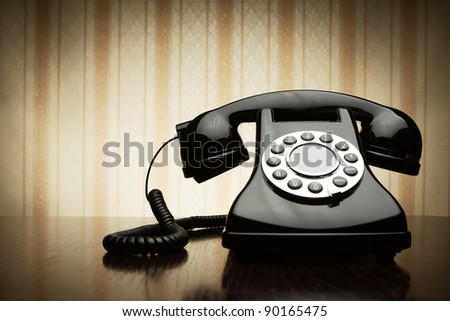 Vintage telephone over striped wallpaper - stock photo