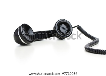 Vintage telephone receiver isolated on white background - stock photo