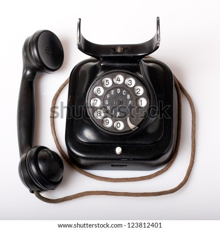 Vintage telephone with marks of use - stock photo