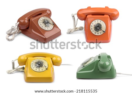 Vintage telephones variations collection, isolated on white - stock photo