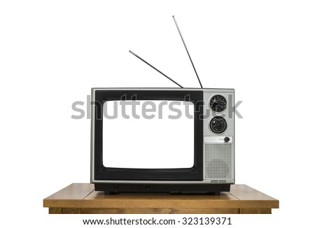 Vintage television on wood table isolated on white with cut out screen. - stock photo