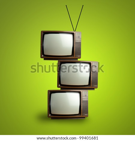 vintage television pile over green background - stock photo