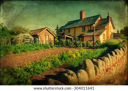 vintage textured picture of a cottage with garden in Allerford, Somerset, England - stock photo