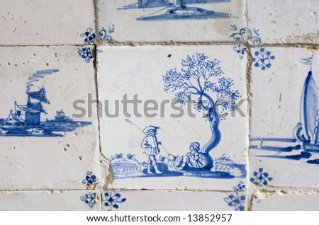 Vintage 17th century Delft blue tile. Image of two shepherds. One standing one sitting under a tree