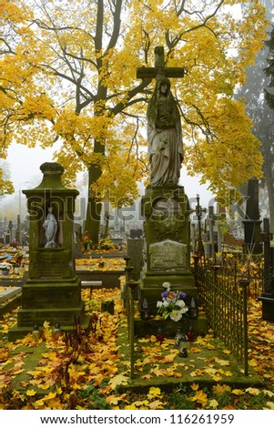 Vintage 19th century graves in a graveyard in autumn - stock photo