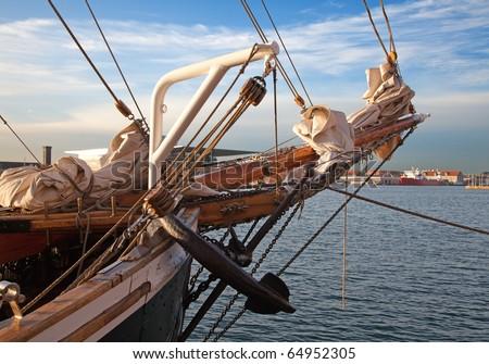 Vintage 19th-century sailing ship mast, anchor and sails - stock photo