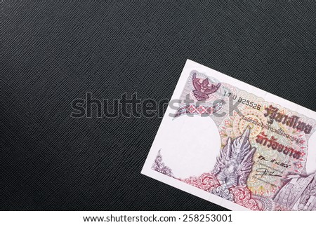 Vintage Thailand five hundred baht banknotes put on the black color leather background represent the Thai financial and monetary related. - stock photo