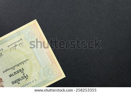 Vintage Thailand one hundred baht banknotes put on the black color leather background represent the Thai financial and monetary related. - stock photo