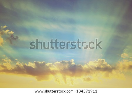 vintage the rising sun on blue sky with clouds - stock photo