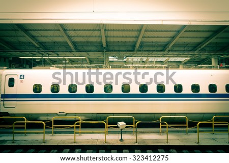 vintage The side of the train Passengers waiting at train station - stock photo