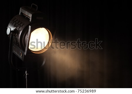 vintage theater spot light on black curtain with smoke - stock photo