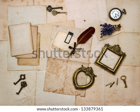 vintage things, picture frames, keys, flowers, old letters and photos. nostalgic sentimental paper background - stock photo