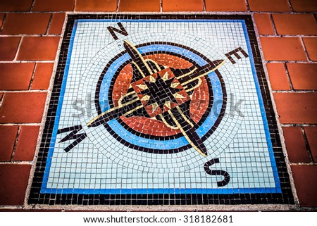 Vintage tile compass rose on floor - stock photo