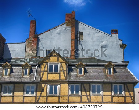 Vintage Timbered House and grey gable as background. - stock photo