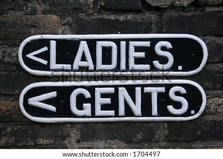 Vintage toilet signs - stock photo