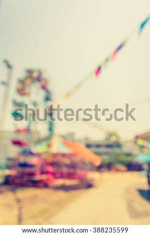 vintage tone blur image of theme park on day time for background usage. - stock photo