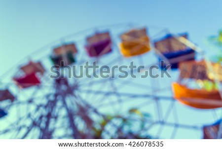 vintage tone blur image of theme park on day time for background usage . - stock photo