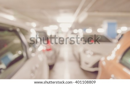 vintage tone blur image with bokeh of Car park interior for background usage. - stock photo