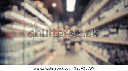 vintage tone blurred image of  supermarket and variety product for background usage . - stock photo