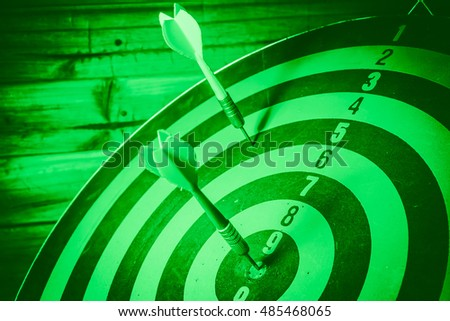 Vintage Tone: Bullseye is a target of business. Dart is an opportunity and Dartboard is the target and goal. So both of that represent a challenge. - Target marketing or target arrow concept.