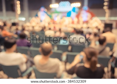 vintage tone image of blur people in concert hall for background usage .