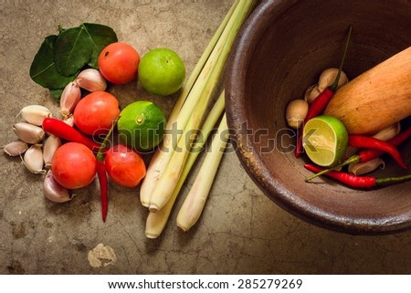 Vintage tone mortar and pestle, thai cooking tool - stock photo