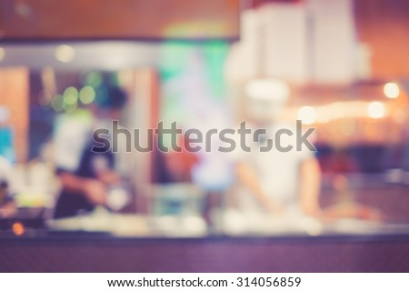 Vintage tone of Abstract blur of Pizza or italian restaurant with chef in the background - stock photo
