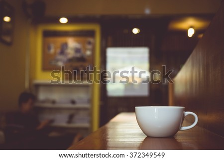 Vintage tone of cup of coffee on table in cafe - stock photo