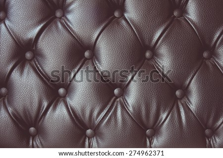 vintage tone of leather texture with buttoned pattern - stock photo