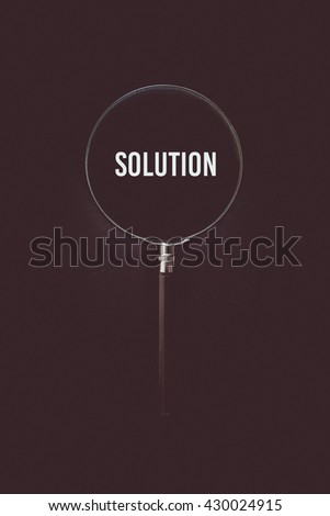 Vintage tone of Solution, word in Magnifying glass - stock photo