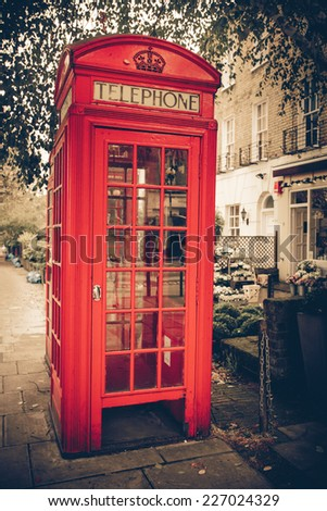 Vintage tone red London telephone booth - stock photo