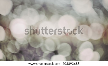 Vintage toned blurred picture of a water drops on window, abstract background.