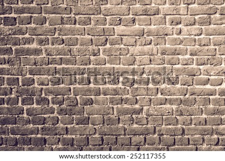 Vintage toned brick wall for texture or background - stock photo