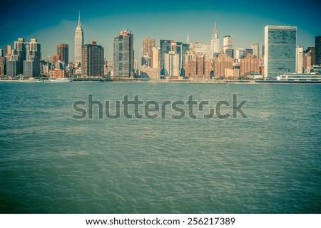 Vintage toned image of New York City skyline across river - stock photo