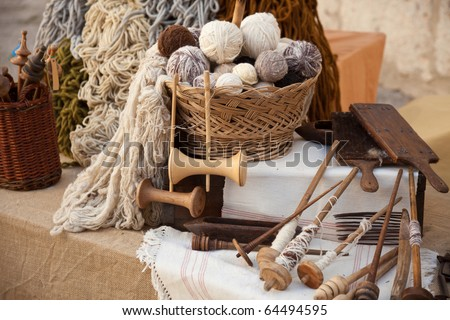 vintage tools and natural wool to make ecological clothing - stock photo