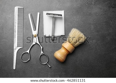 Vintage tools of barber shop on grey background