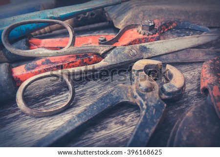 vintage tools - old gardening tools on wooden background